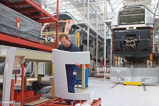 An employee works on production of the Desiro ML train at the Siemens Mobility plant in Krefeld, Germany, on Monday, June 23, 2008. Siemens AG,...