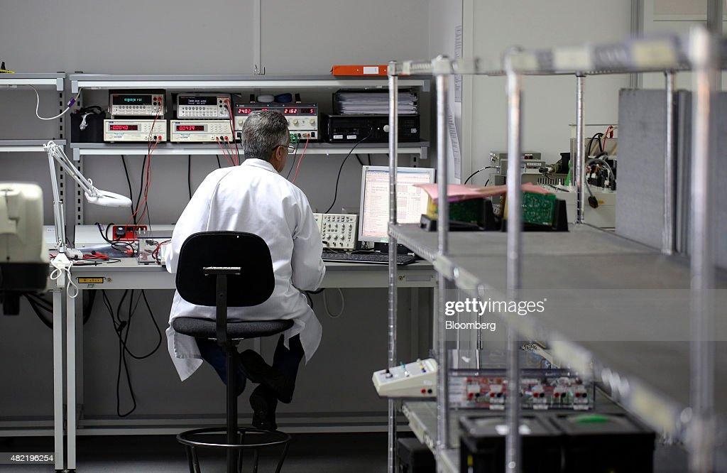 An employee works on testing printed circuit boards at Texcel Technology Plc's factory in Dartford, U.K., on Tuesday, July, 28, 2015. U.K. economic growth accelerated in the second quarter as business services and finance strengthened and North Sea output surged. Photographer: Chris Ratcliffe/Bloomberg via Getty Images