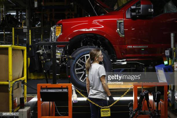 An employee works on the assembly line at the Ford Motor Co Kentucky Truck Plant in Louisville Kentucky US on Friday Oct 27 2017 For BMW AG Tesla Inc...