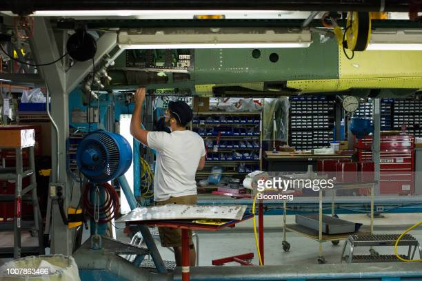 An employee works on the assembly line of the Boeing Co F15 Strike Eagle fighter aircraft at the Boeing Defense Space Security facility in St Louis...