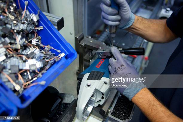 An employee works on the assembly of a Bosch electric angle grinder at the professional power tools division of Robert Bosch GmbH in Leinfelden...