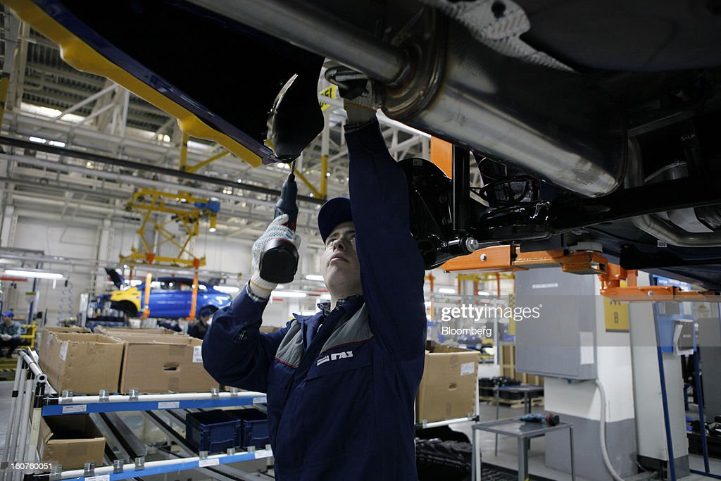 An employee works on the assembly of a Chevrolet Aveo automobile, a division of General Motors Co. (GM), on the production line at the GAZ Group plant in Niznhy Novgorod, Russia, on Tuesday, Feb. 5, 2013. GAZ, which is controlled by Russian billionaire Oleg Deripaska, plans to make 30,000 Aveo sedans and hatchbacks a year at its plant in Nizhny Novgorod starting in mid-2012. Photographer: Alexander Zemlianichenko Jr./Bloomberg via Getty Images