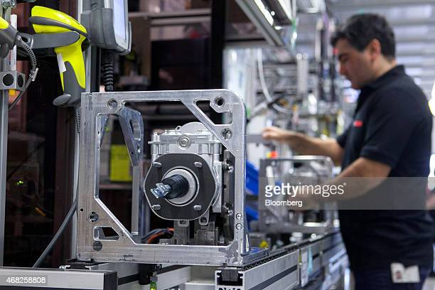 An employee works on the Bosch iBooster autonomous automobile braking assistance production line at the Robert Bosch GmbH plant in Blaichach Germany...