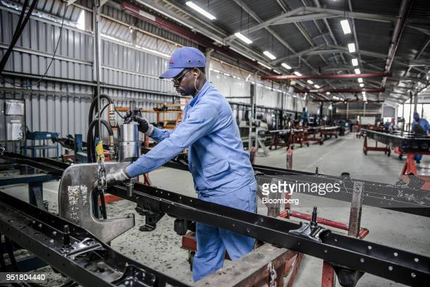 An employee works on the chassis of an Isuzu truck on the assembly line inside the Isuzu East Africa Ltd plant in Nairobi Kenya on Thursday April 26...