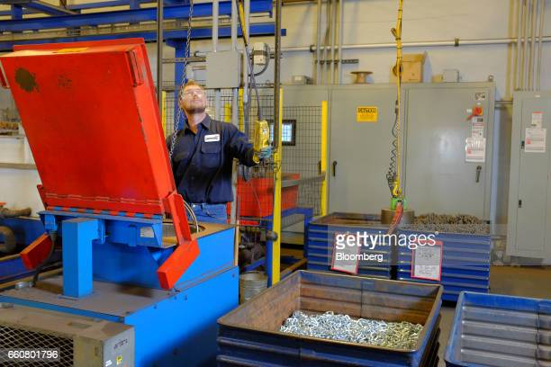 An employee works on the electro zinc plating line during production at the Pewag Inc manufacturing facility in Pueblo Colorado US on Wednesday March...