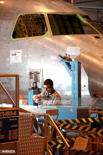 An employee works on the Embraer structural assembly line of the airplane model 170190 at the Empresa Brasileira de Aeronautica SA Embraer...