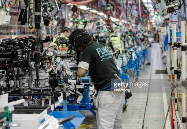An employee works on the engine assembly line inside the Renault SA factory in Flins France on Thursday Feb 23 2017 Carlos Ghosn one of the auto...