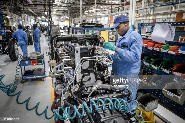 An employee works on the engine of an Isuzu truck on the assembly line inside the Isuzu East Africa Ltd plant in Nairobi Kenya on Thursday April 26...