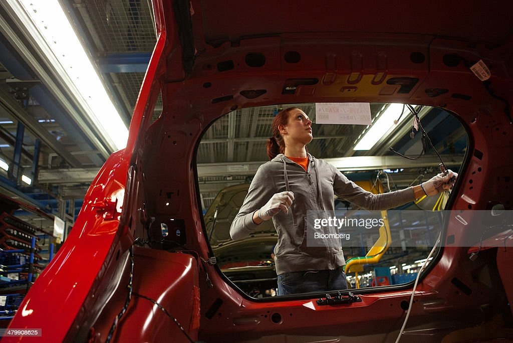 An employee works on the Ford Fiesta automobile production