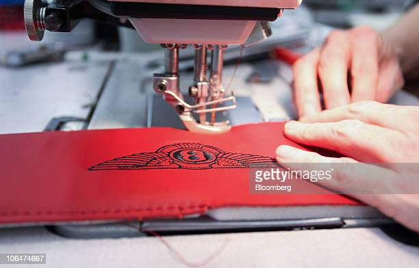 An employee works on the leather headrest for an automobile at the Volkswagen AG Bentley factory in Crewe UK on Tuesday Nov 2 2010 Bentley Volkswagen...