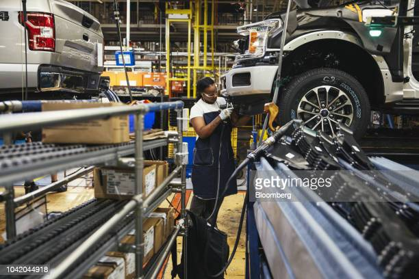 An employee works on the line at the Ford Motor Co. Dearborn Truck Plant in Dearborn, Michigan, U.S., on Thursday, Sept. 27, 2018. Ford Motor Co.Is...