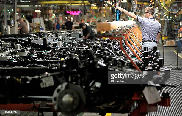 An employee works on the line at the General Motors Co. Assembly plant in Flint, Michigan, U.S., on Monday, July 18, 2011. General Motors Co. Will...