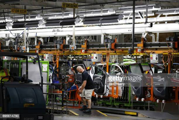 An employee works on the production line at the General Motors Co Orion Assembly Plant in Orion Township Michigan US on Tuesday June 13 2017 The...