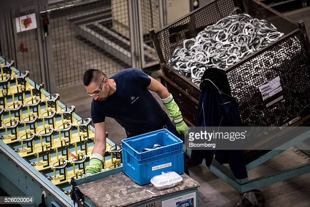 An employee works on the production line at the Mercedes-Benz AG automobile plant, operated by Daimler AG, in Kecskemet, Hungary, on Friday, April...