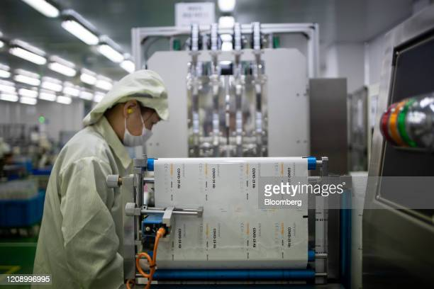 An employee works on the production line of Ichroma Covid19 Ab testing kit at Boditech Med Inc headquarters in Chuncheon South Korea on Friday April...