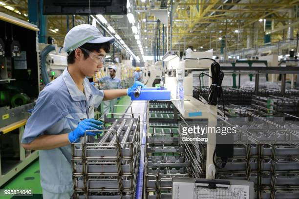 An employee works on the production line of Jtekt Corp's Hanazono plant in Okazaki Aichi Prefecture Japan on Tuesday July 10 2018 JTEKT will make an...