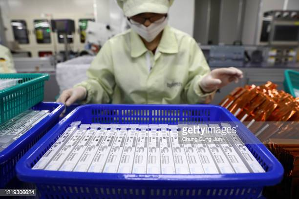 An employee works on the production line of the AFIAS Covid19 Ab testing kit used in diagnosing the coronavirus at the Boditech Med Inc headquarters...