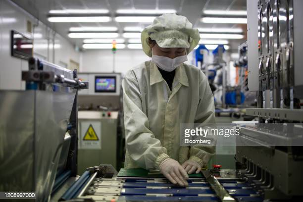 An employee works on the production line of the Ichroma Covid19 Ab testing kit at the Boditech Med Inc headquarters in Chuncheon South Korea on...