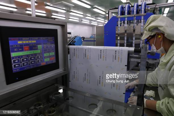 An employee works on the production line of the Ichroma Covid19 Ab testing kit used in diagnosing the coronavirus at the Boditech Med Inc...