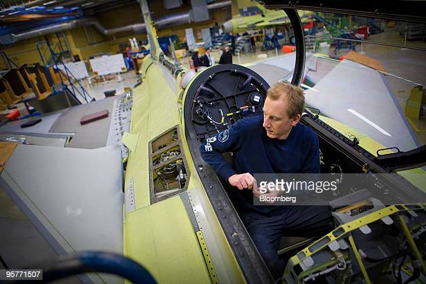An employee works on the production of a Saab Gripen fighter jet at the company's factory in Linkoping Sweden on Wednesday Jan 13 2010 Saab AB the...