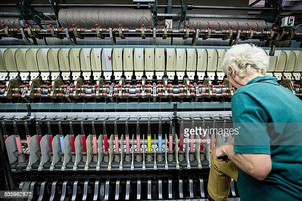 An employee works on the spinning process of cashmere wool at Loro Piana SpA's plant in Roccapietra Italy on Wednesday May 11 2016 About...