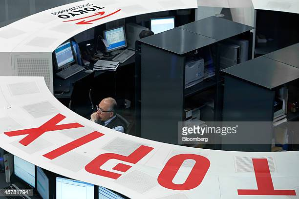 An employee works on the trading floor of the Tokyo Stock Exchange in Tokyo Japan on Thursday Dec 19 2013 The yen touched the weakest since October...