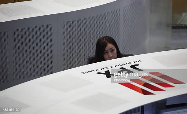 An employee works on the trading floor of the Tokyo Stock Exchange operated by Japan Exchange Group Inc in Tokyo Japan on Tuesday Aug 25 2015...