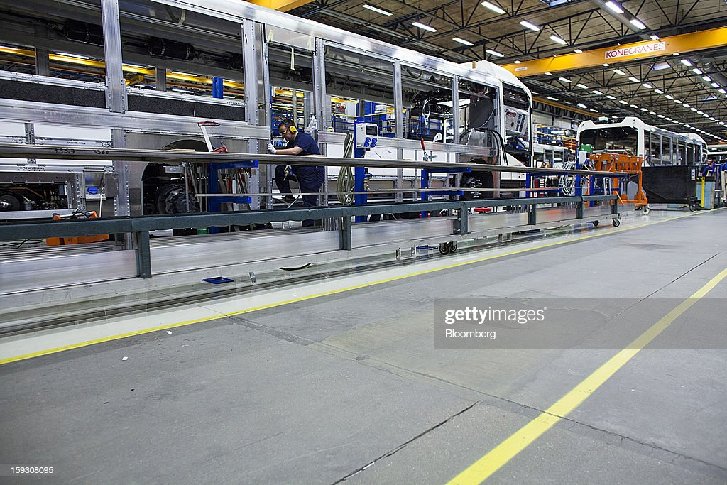 An employee works on the upper structure of a bus during assembly on the production line at Volvo AB's bus manufacturing plant in Wroclaw, Poland, on Friday, Jan. 11, 2013. Volvo plans to end bus making in Saeffle by June 2013, and will consolidate the business in Europe to its main plant in Wroclaw, Poland, the Gothenburg, Sweden-based company said. Photographer: Bartek Sadowski/Bloomberg via Getty Images