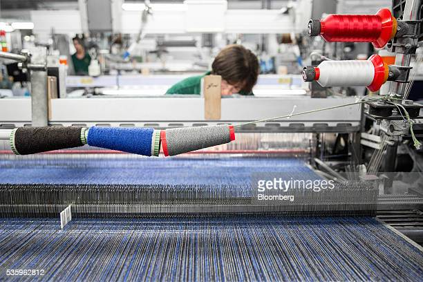 An employee works on the weaving process of cashmere wool at Loro Piana SpA's plant in Roccapietra Italy on Wednesday May 11 2016 About threequarters...