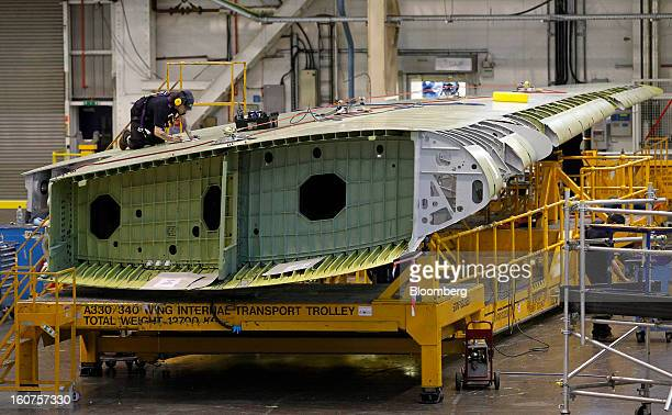 An employee works on the wing assembly of an Airbus A330 passenger aircraft at the company's factory in Broughton UK on Monday Feb 4 2013 Airbus SAS...
