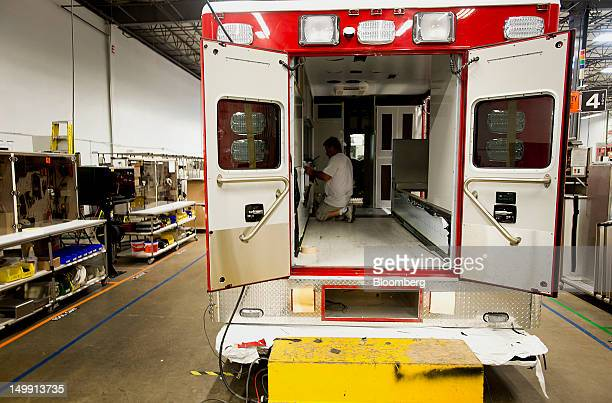 An employee works on the wiring of an ambulance module at the Horton Emergency Vehicles facility in Grove City Ohio US on Friday Aug 3 2012 Horton...