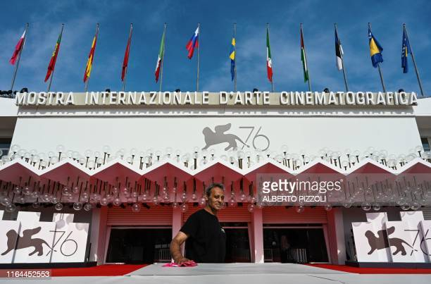 An employee works outside the Palazzo del Cinema on August 28, 2019 on the opening day of the 76th Venice Film Festival at Venice Lido.