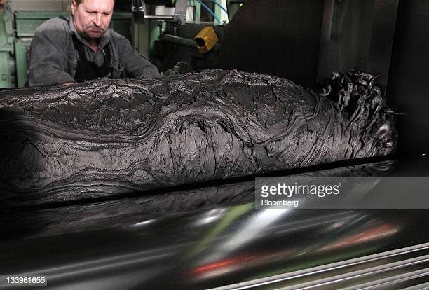 An employee works with a rubber mixture on the production line at the ZAO Sibur Holding tire manufacturing plant in Voronezh, Russia, on Friday, Nov....