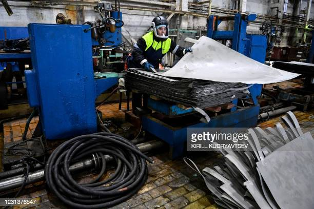 An employee works with nickel sheets at Kola Mining and Metallurgical Company , a unit of Russia's metals and mining company Nornickel, in the town...