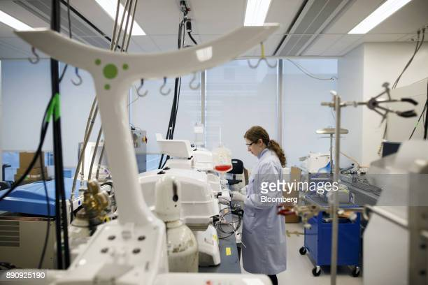 An employee works with Xuri bioreactors in the laboratory of the Centre for Commercialization of Regenerative Medicine at the MaRS Discovery District...