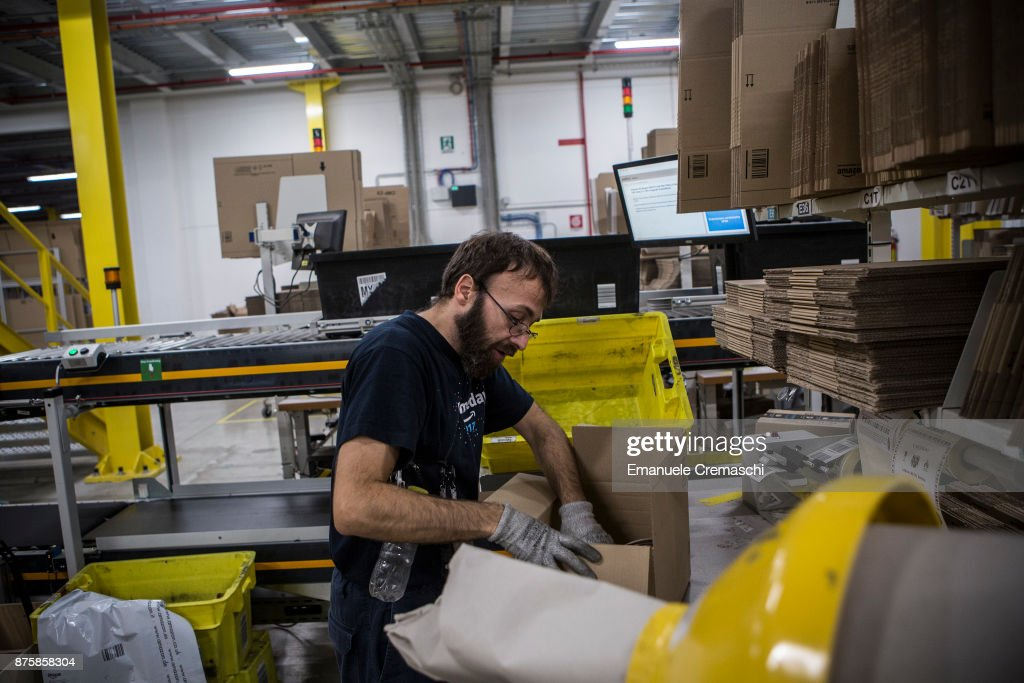 An employee wraps a box of merchandise at the Amazon.com MPX5 fulfillment center on November 17, 2017 in Castel San Giovanni, Italy. Established in 2014, the 100.000 sq. metres warehouse employs a workforce of 1.600 people who processed 1.2 million items during the last Black Friday.