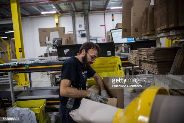 An employee wraps a box of merchandise at the Amazoncom MPX5 fulfillment center on November 17 2017 in Castel San Giovanni Italy Established in 2014...