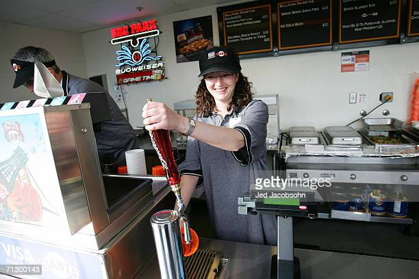 An employeee of the Dirby Grill pours beer before the San Francisco Giants play against the Los Angeles Dodgers during the MLB game at ATT Park on...
