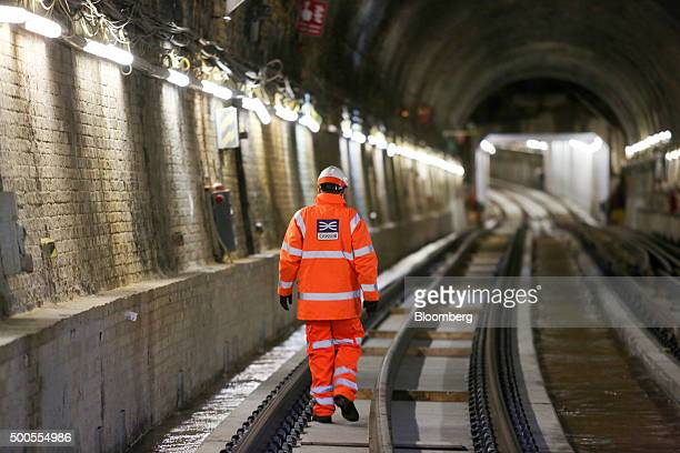 An employees passes lengths of laid track in the Crossrail Connaught tunnel in London UK on Tuesday Dec 8 2015 Crossrail the UK government project to...