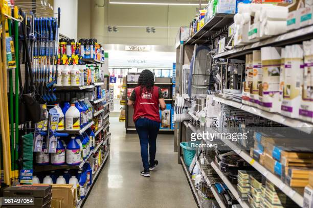 An employees walks down an aisle at a Lowe's Cos store in New York US on Tuesday May 22 2018 Lowe's Cos is scheduled to release earnings figures on...