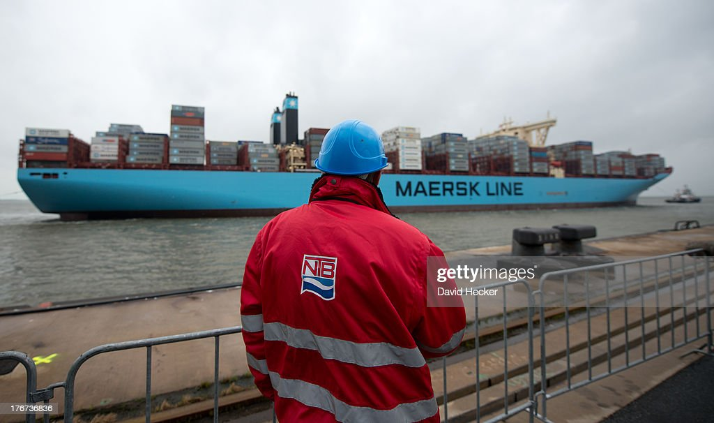 An employees watches the world's biggest container ship, the Maersk MC-Kinney Moller as it arrives at the port of Bremerhaven on August 18, 2013 in Bremerhaven, Germany. The world's largest container ship, the Maersk MC-Kinney Moller, arrives at the port of Bremerhaven on Sunday. It has a length of 400 meters, it is 59 meters wide and is capable of delivering 18.000 TEU Container. The ship carries the first Triple-E Standard (Economy of Scale, Energy Efficiency, Environmentally-improved) and is the most efficient and energy saving container ship in the world.