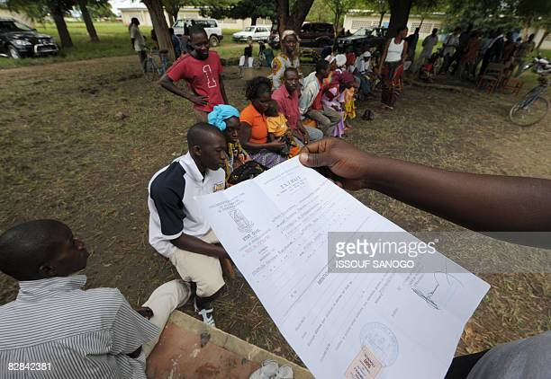 An employer of the Sagem company verifies a birth certificate on September 16 2008 in Ferkessedougou during the second day of the electoral...
