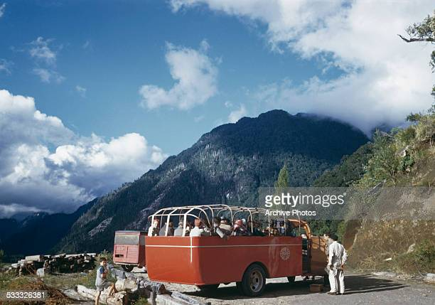 An Empresa Andina del Sud coach takes tourists up a mountain in Chile South America circa 1965