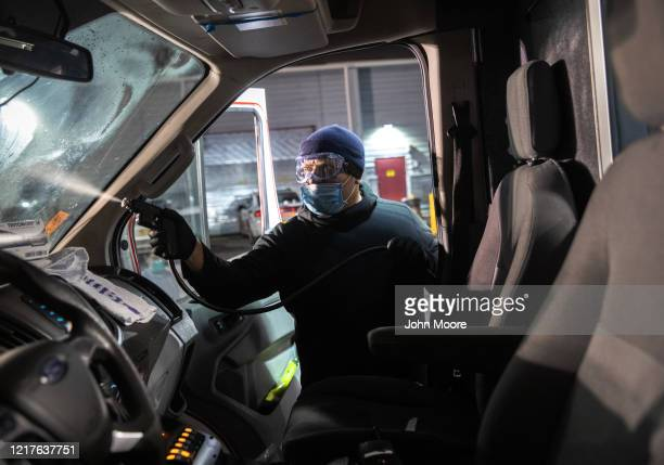 An Empress EMS employee decontaminates an ambulance on April 06 2020 in Yonkers New York Empress paramedics and EMT's treat and transport patients to...