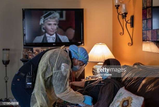 An Empress EMS paramedic treats an 81yearold patient with COVID19 symptoms before taking her to a hospital as Barbara Stanwyck in The Big Valley...