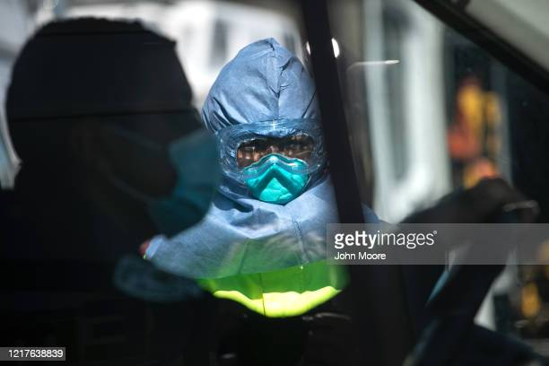 An Empress EMS worker wearing personal protective equipment prepares to decontaminate an ambulance that transported a suspected COVID19 patient on...