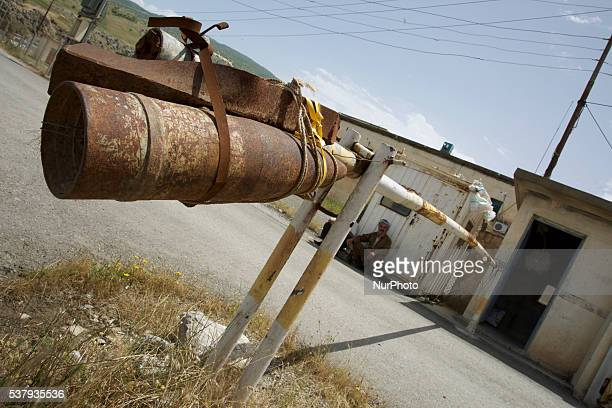 An empty 155 mm artillery shell used a weight on a boom gate in Soran Kurdish region of Iraq on 17 May 2016