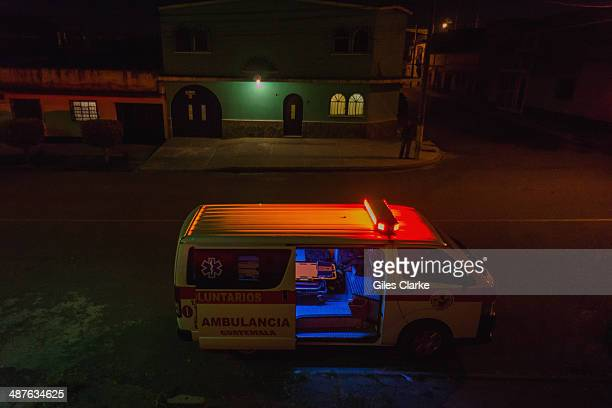 An empty ambulance waits in the middle of the night January 16 2014 in Guatemala City Guatemala The bomberos voluntarios are a volunteer fire...