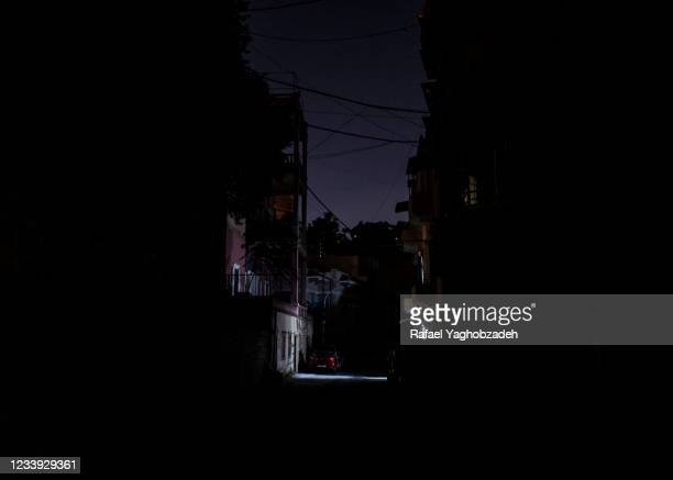 An empty and dark street in the district damaged by the port explosion on July 11, 2021 in Beirut, Lebanon. Lebanon is struggling with severe...