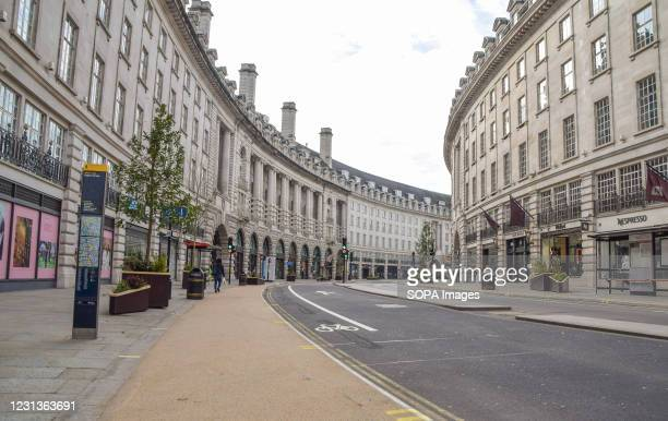 An empty and deserted Regent street in London, where shops remain closed. England will begin easing the lockdown restrictions in several stages from...